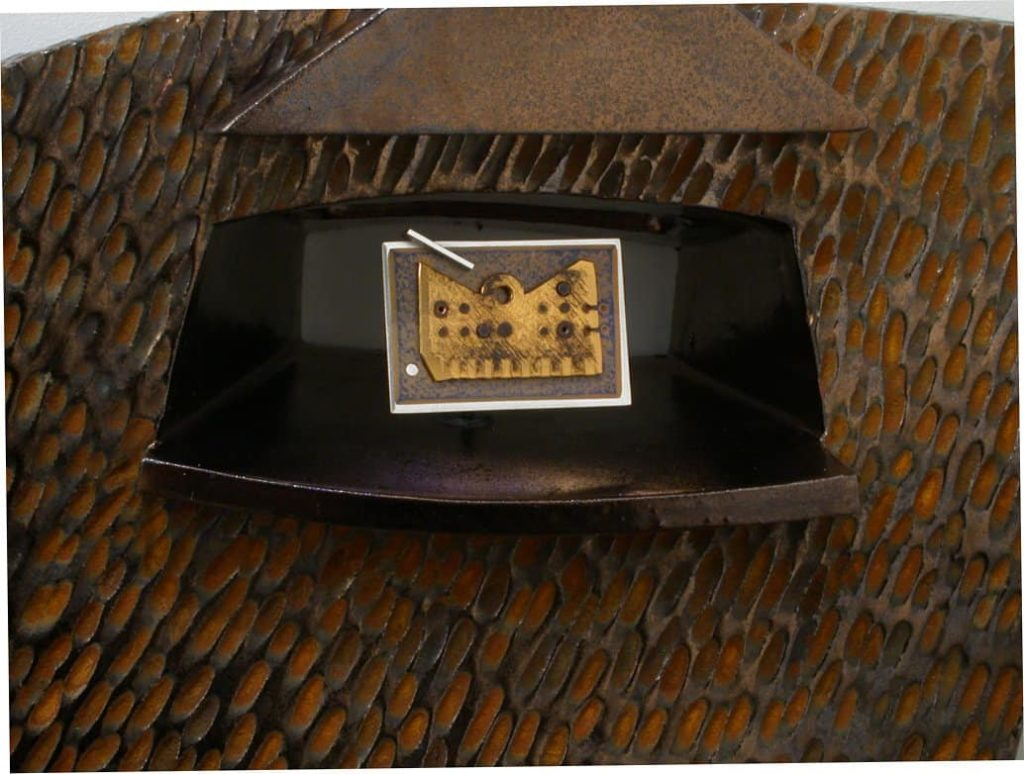Trudy Golley and Paul Leathers, (Rusty) Reliquary, ceramic wall piece with removable metal brooch, multi-fired ceramic, rust finish, with Sterling silver, 24Kt. gilt copper and anodised niobium, 29 x 17 x 8cm, photo by Paul Leathers, made in Nelson, British Columbia, Canada