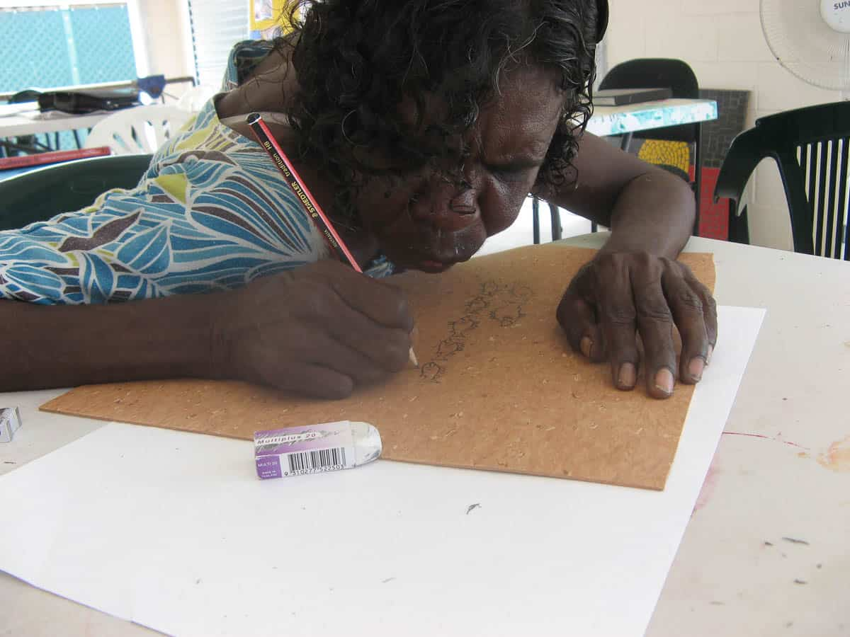 Dolsi Norman planning a linocut print