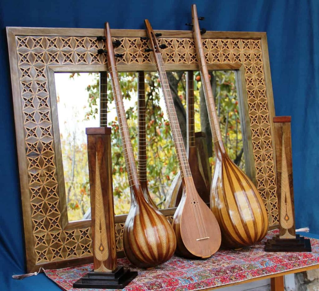 Bahram Taherian, Cancellate mirror frame and musical instruments in the picture contains brass plates and gelatin glue, 2014, walnut, boxwood, maple and cashew