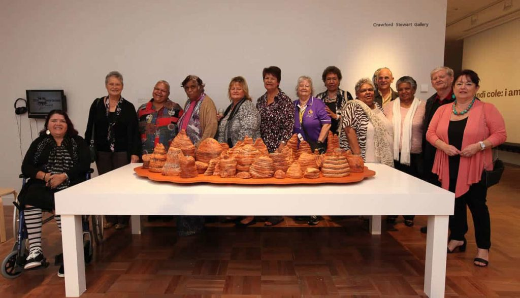 "Bankstown Koori Elders Group with their 2014 Indigenous Ceramic Art Award winning work ""After the Rain"" Bungle Bungle, 2013. Collection Shepparton Art Museum (SAM) © the artists. Photo: Amina Barolli."