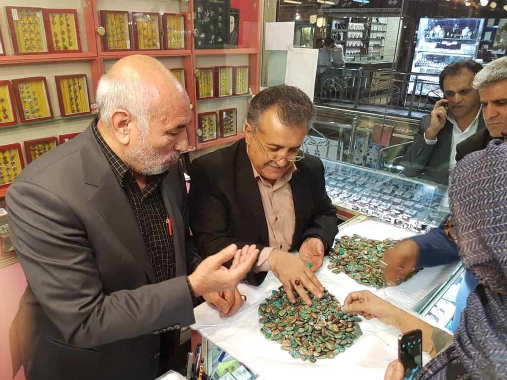 The great union organiser Mr Rahini sharing his stock of turquoise