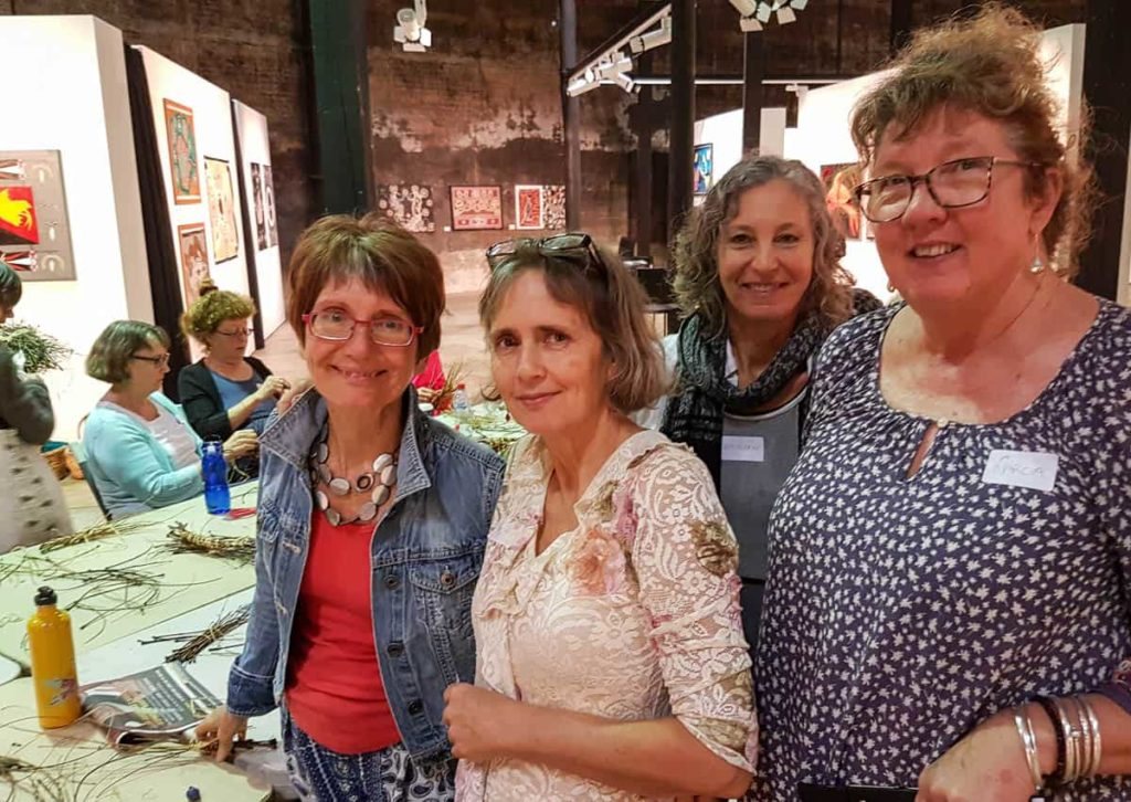 Saltwater Creek Basketry group sewing seeds for a Sculpture Botanica in Cairns, October 2016