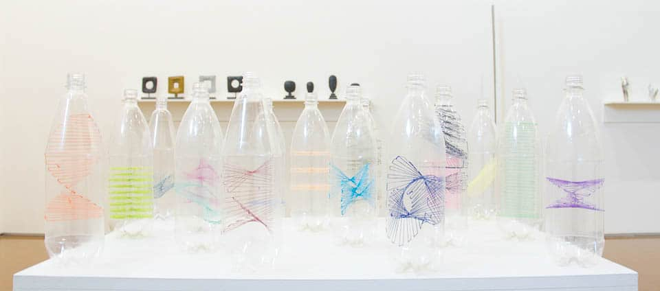 Kylie Stillman, Bottle Drawings, 1999, plastic bottles and embroidery thread, 29.5 x 9 cm (diameter)