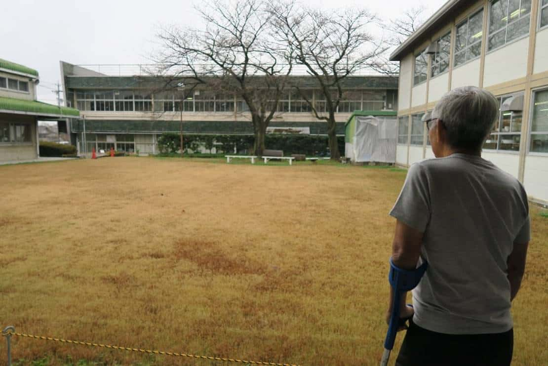 Iskandar looking at the field of Tajimi City Pottery Design and Research Centre where he used to engage in sporting activities as a student.