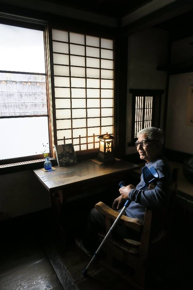Iskandar sitting in the study of the artist at the Kawai Kenjiro House, which is now a museum located in Higashiyama-Gjo, in eastern Kyoto.