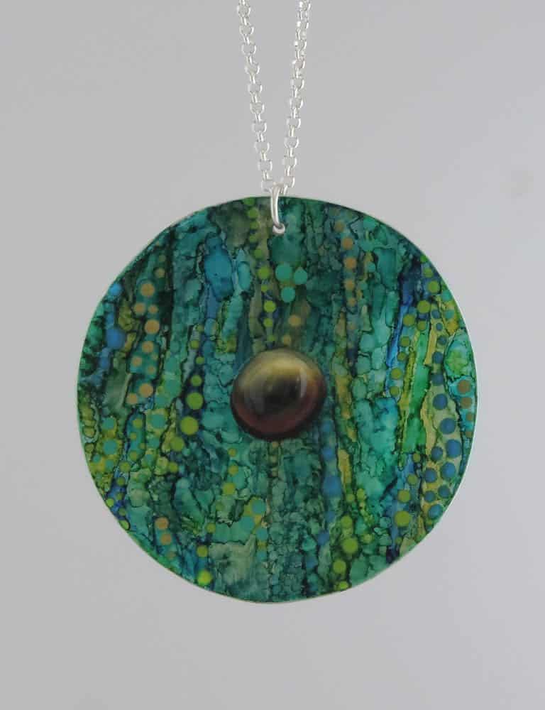 Jordana Angus, gadhang-yadhaa (Ocean dream), 2016 aluminium, ink, acrylic paint, , ice resin, 7cm diameter, photo: Jordana Angus