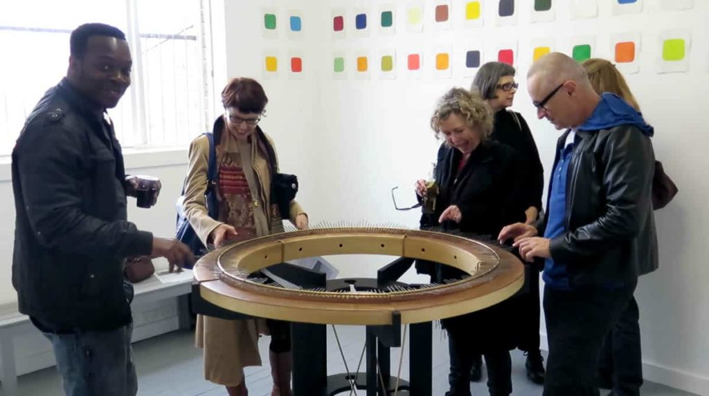 Visitors playing the social lamellaphone at SNO Contemporary Art Projects, Marrickville Sydney NSW, 2014, photo: Gary Warner