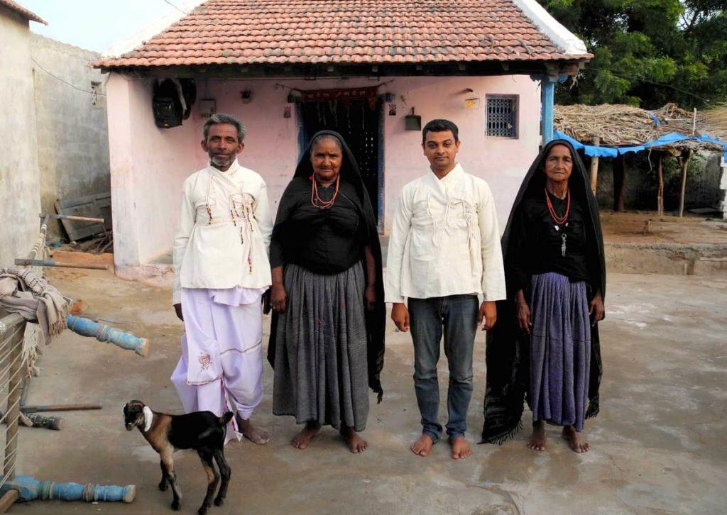 Lakhabahi Rabari wearing the kediyun made by LOkesh Ghai and LOkesh Ghai wearing the kediyun made by Badhiben and Puiben.