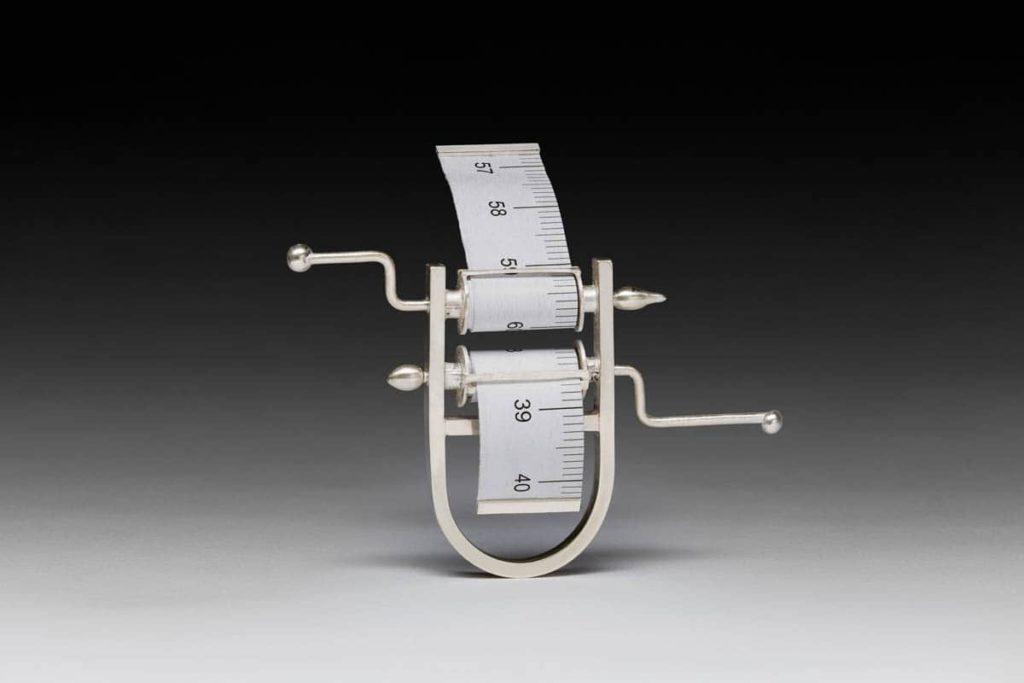 Xiaohui Yang, Relationship Measurement Series, 2015, silver, paper measuring tape, 7x3x9xcm, photo:Lisa Brown