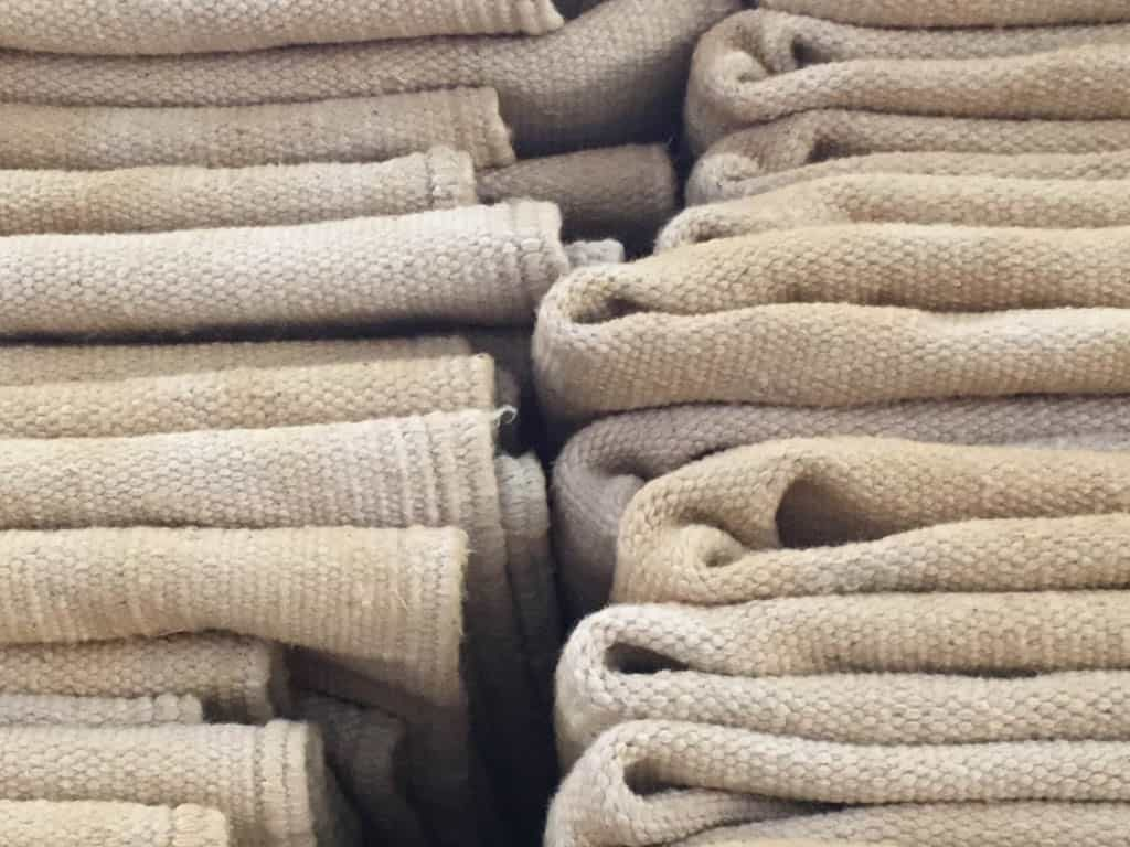 Natural cotton dhurri rugs before dyeing
