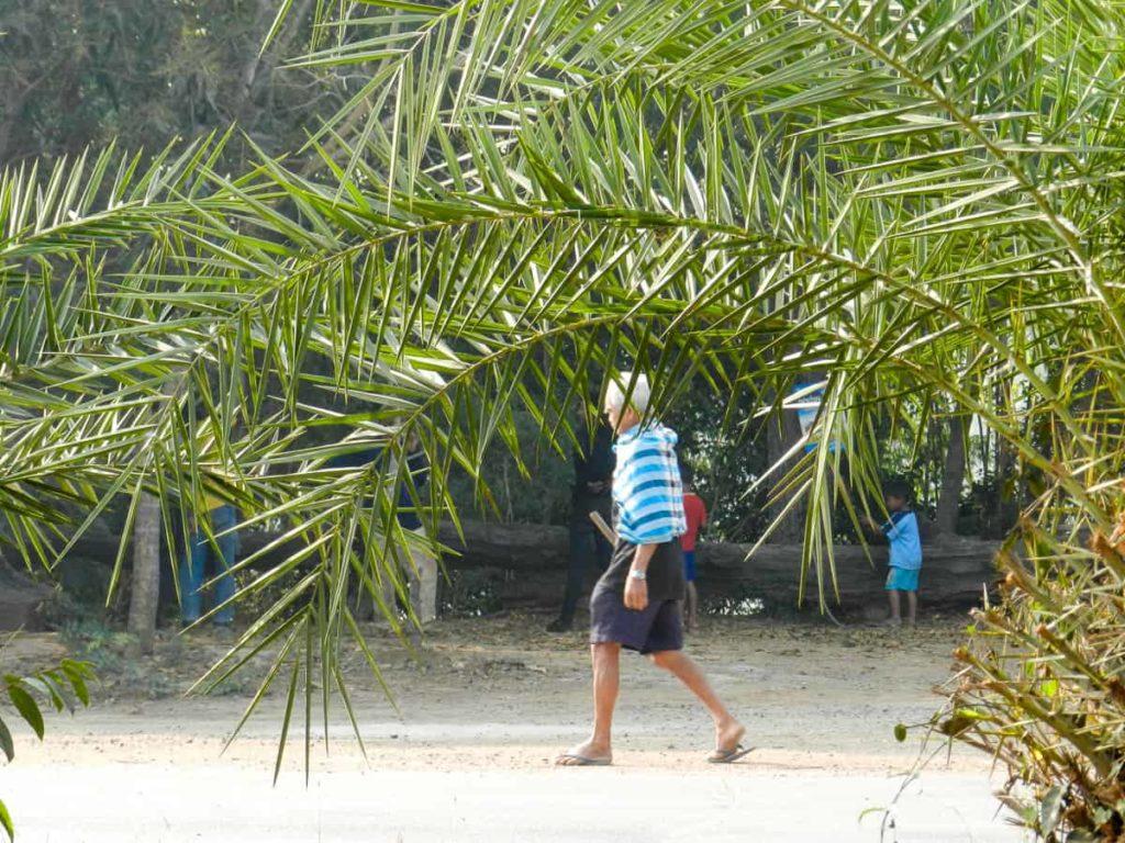 Pakama village life: farmer walking to the fields