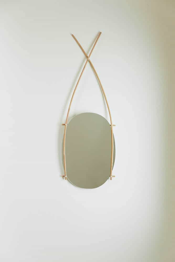 Nian means smooth and delicate, like a boiled then peeled egg. A form follows structure frame with a hand cut oval shape,  this hanging mirror reminds an image of eggs in a bamboo basket hung upon a natural hot spring.