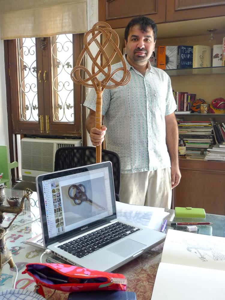 Ishan showing an antique German carpet beater collected in Australia that resembled an item from Mandy's photo archive