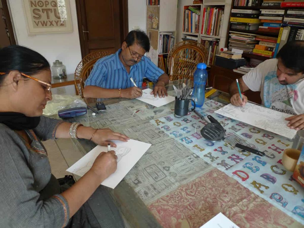 Pushpa, Pradyumna and Ishan absorbed in their drawings