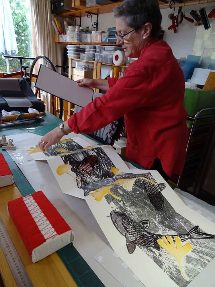 Ann Baxter doing final fit of book and container