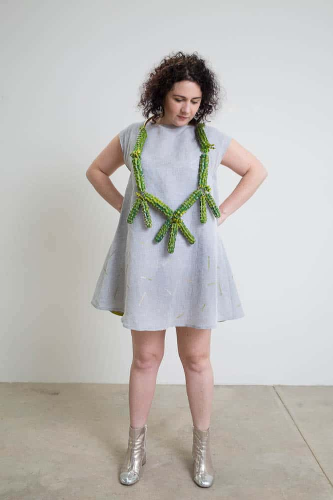 Lauren Simeoni, Cactus neckpiece, 2016, artificial foliage, brass, beads, paint; Cactus dress, 2017, short grey Linen-cotton with chartreuse appliqué, hand cut stencil print, one-off, photo: Craig Arnold