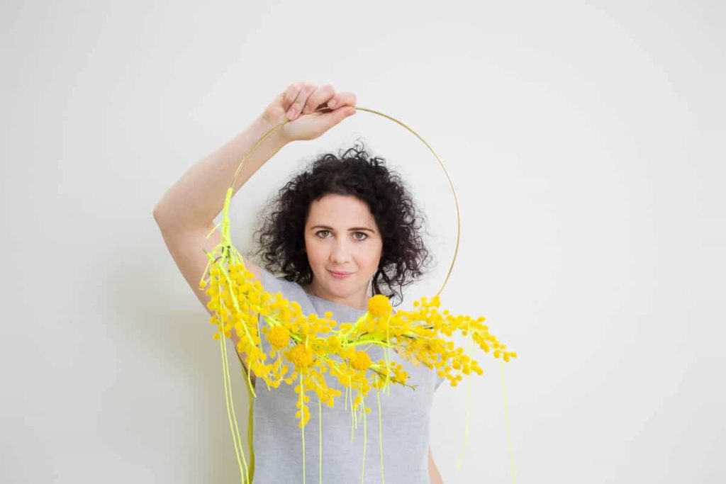Lauren Simeoni, Wattle lei, 2017, artificial foliage, metal ring, thread, paint; Lauren Simeoni, Wattle dress, Short grey + chartreuse linen-cotton, hand cut stencil print, one-off, photo: Craig Arnold