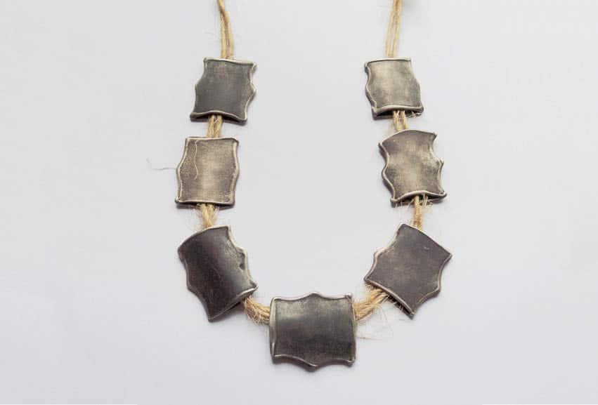 Areta Wilkinson, Mau kaki, Neckpiece, 2013, oxidised sterling silver, flax bailing twine, 300 x 220 x 5mm