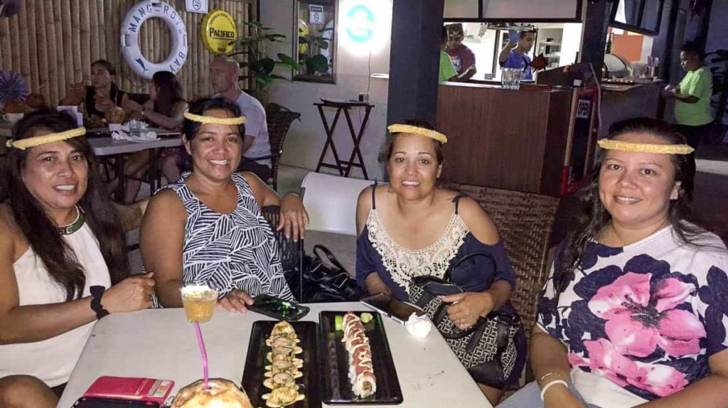 Author and friends wearing elinpwur at Mangrove Bay Bar, Pohnpei, Micronesia
