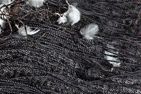 Tui cloak, (close up) harakeke, muka, copper, feathers, photo:Norm Heke