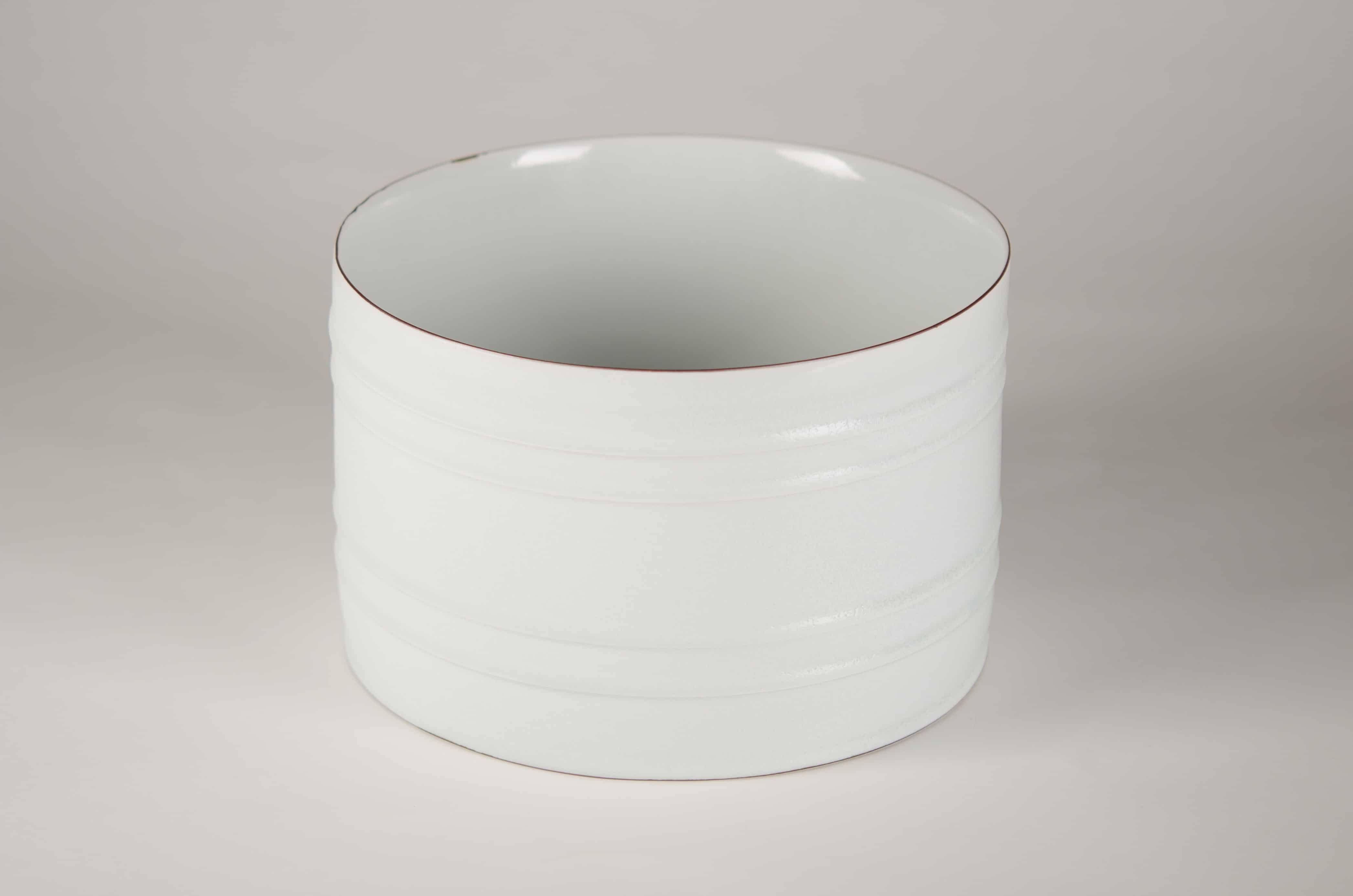 Kirsten Coelho, Large bowl, porcelain matt white/pale blue sheen glaze. banded iron oxide, approx. 17cm H x 27cm diam, 2015