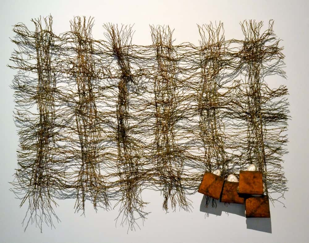 Lorraine Connelly-Northey, Possum skin cloak rafting for fresh water mussels on country, Medium: Rusted rabbit-proof netting wire, iron, tie wire and fresh water mussel shells, Wangaratta Art Gallery Collection, 2015