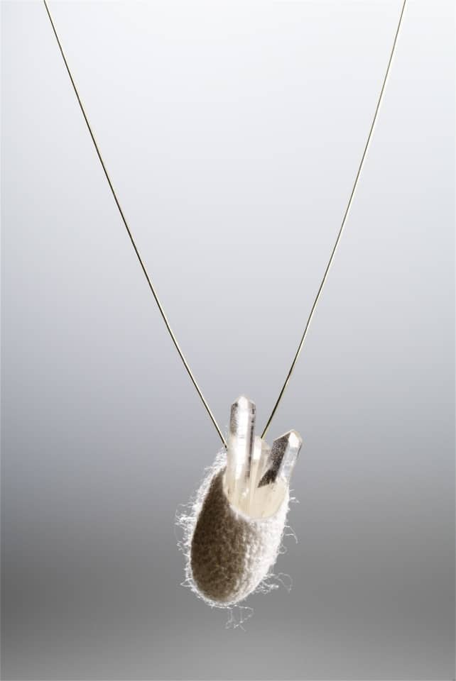 "Martina Dempf, Collier ""Cocoon + Crystal"", 2006, cocoon of mulberry silkworm, mountain crystal, gold, 3 x 4 x 50 cm"