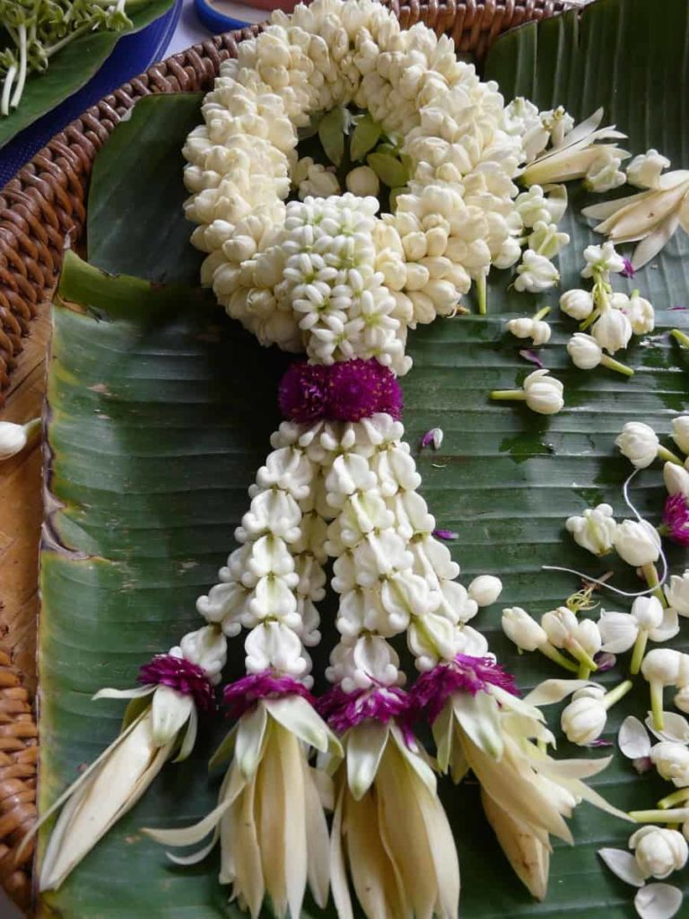 First traditional Phuang Malai I made using Jasmine, Crown flowers, Amaranth and Magnolia flowers. Together the crown flower and amaranth mean never ending love. Pak Kret, Thailand, 2014. Photo: Jess Dare.