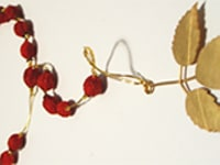 lynn kelly, rosehip rosary (after), gold leaf on sterling silver, rosehip, gold thread, 60 x 8cm, photo: lynn kelly, made in dunedin, new zealand