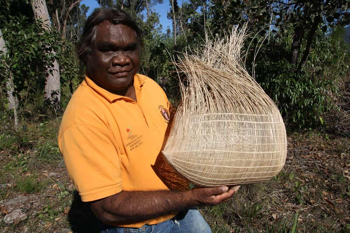 Abe Muriata with work in progress, photo: Valerie Keenan, Girringun Aboriginal Art Centre