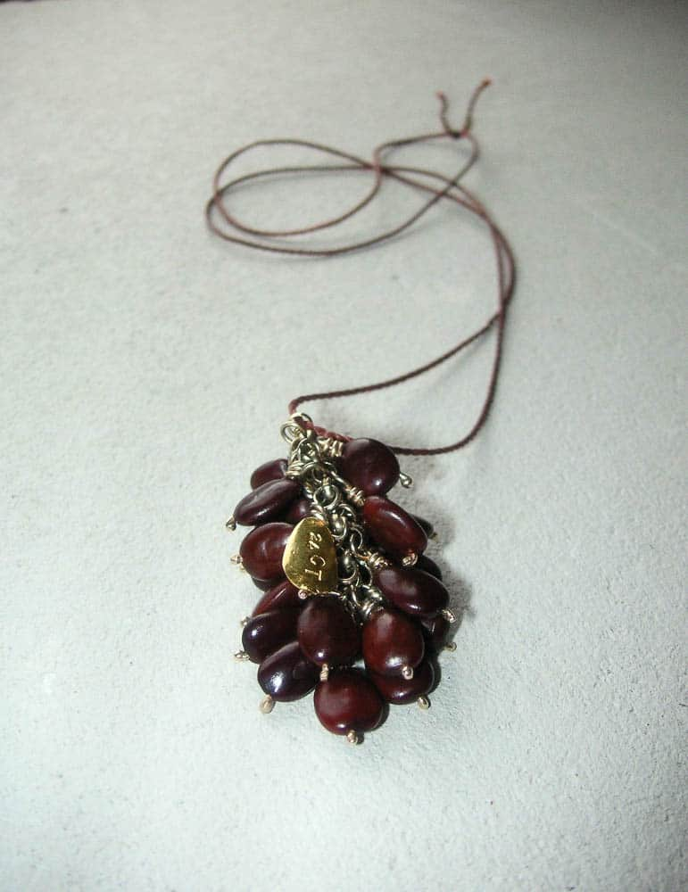 Lynn Kelly, Carob Necklace (After), 24ct Gold, 24 carob seeds, thread, 12 x 4cm, photo: Lynn Kelly, made in Dunedin, New Zealand