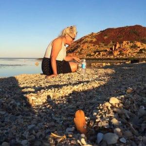 Nicky Hepburn fossicking for tusk shells at Hearsons Cove Burrup Peninsular WA