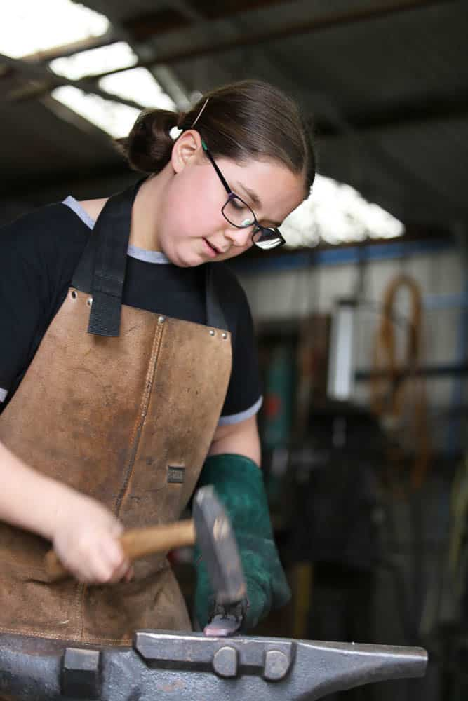 Leila during the bladesmithing process. Image courtesy of the artist