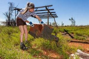 Pennie Jagiello collecting materials at the chicken farm, outside of Roebourne. FORM, Worn Land, 2015, photo: Bewley Shaylor