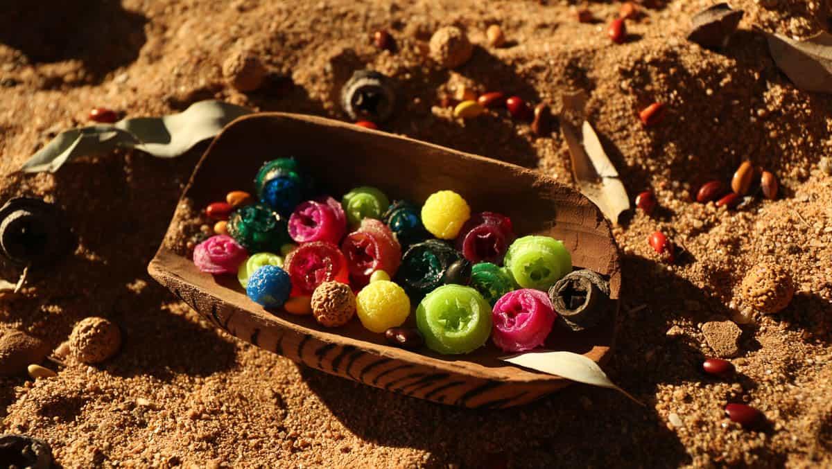 Resin quandong and Eucalyptus seed beads, Ikuntji Artists, 2014, photo: Dan Coutts