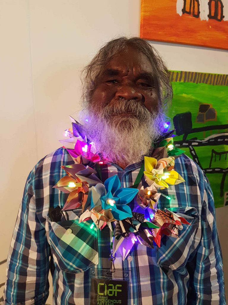 Abe Muriata, master craftsman and expert in the jawun, garlanded in Cairns.