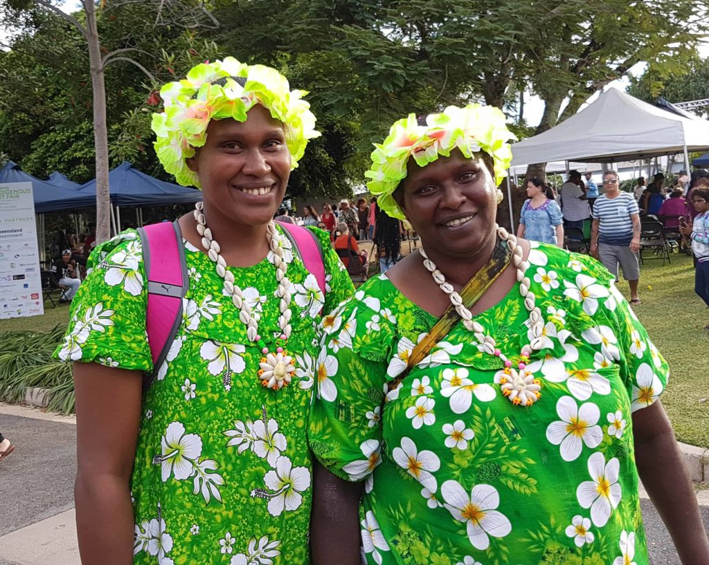 These ladies from York Island don't need any more garlands to brighten up their appearance.