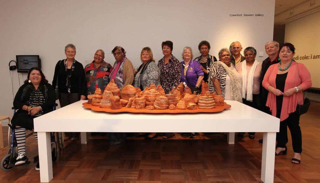 "Bankstown Koori Elders Group with their 2014 Indigenous Ceramic Art Award winning work ""After the Rain"" Bungle Bungle, 2013. Collection Shepparton Art Museum (SAM) © the artists. Photo: Amina Barolli."