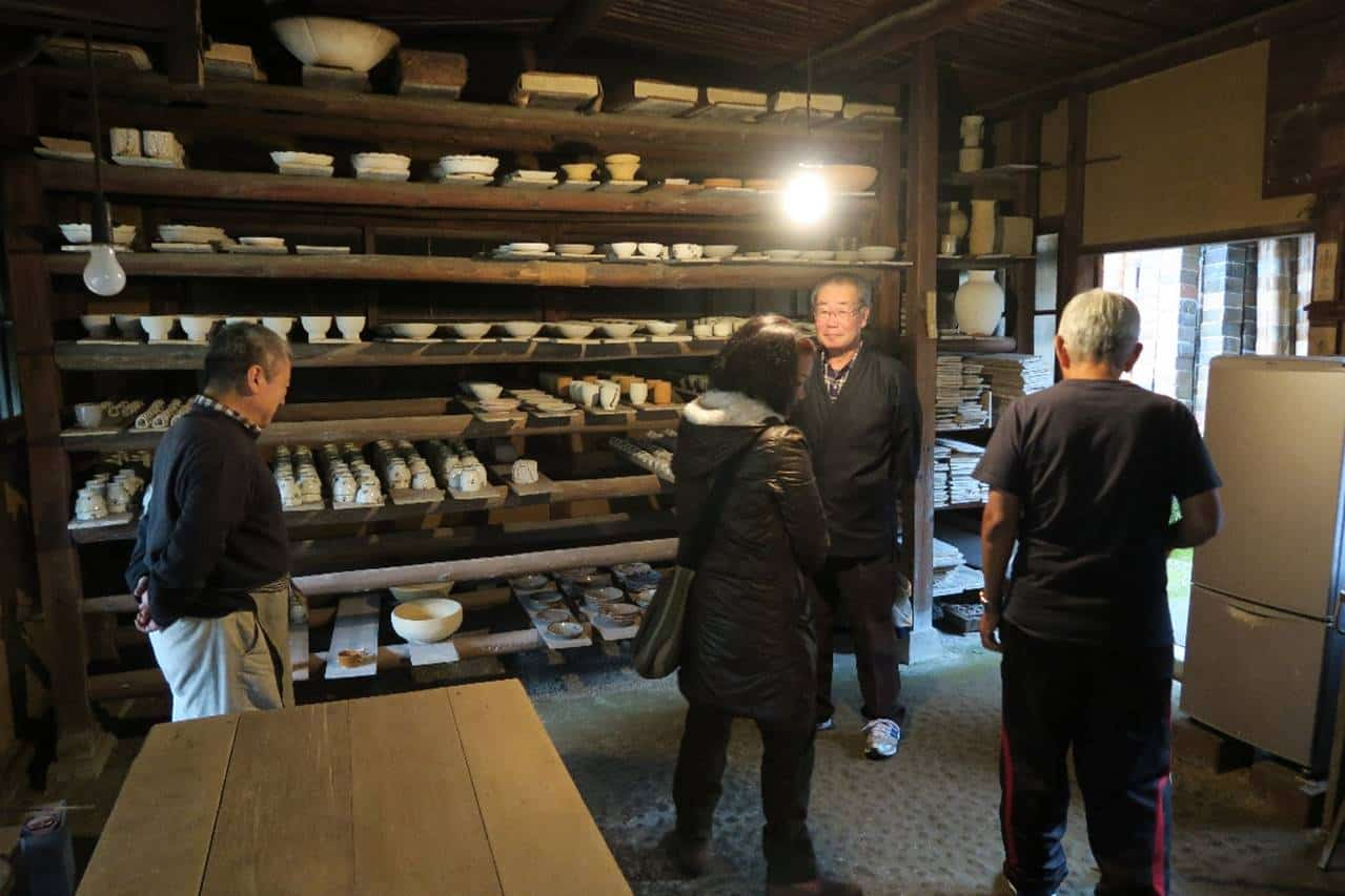 Given a tour of the facilities by a descendent of Arakawa Toyozo (extreme left). Kato Tokuro and Arakawa were responsible for the revival and success of the kilns in Mino which is now located in the Gifu prefecture. Arakawa was designated a 'living national treasure' in 1955 for his work with Shino and Setoguro (black Seto).