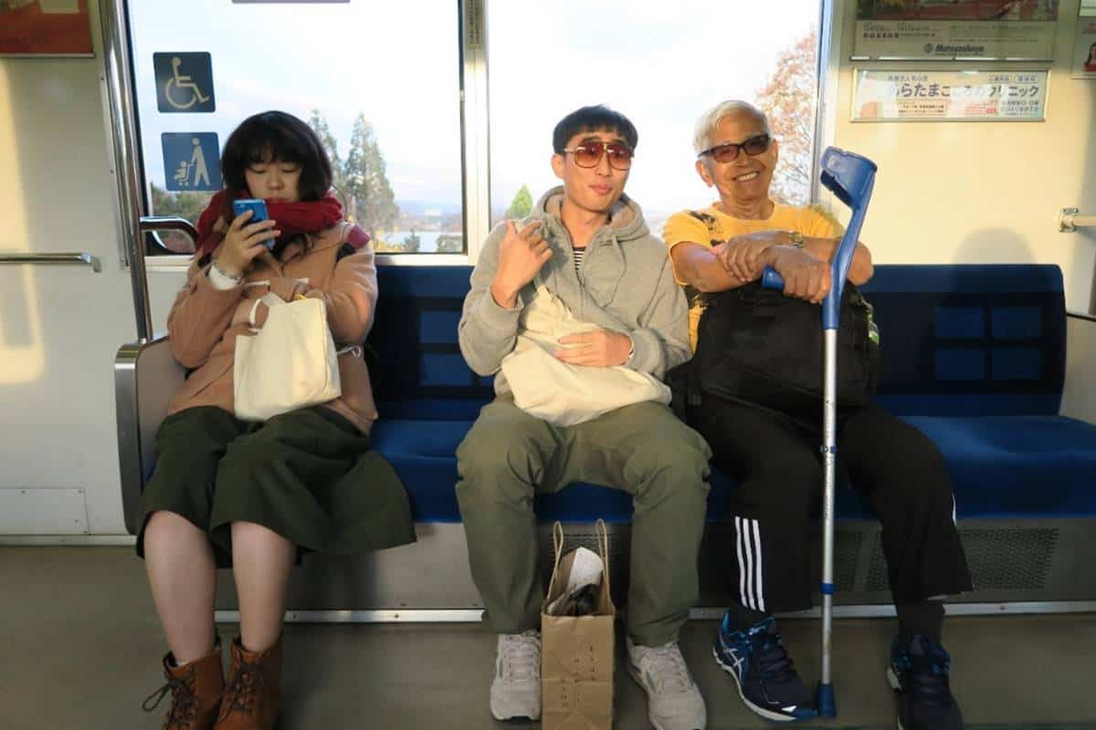 Artist Gerald Leow (middle) with Iskandar (right) on a local train on the way to Tajimi from Nagoya. Iskandar would commute on this train daily for his lessons at the Tajimi City Pottery Design and Research Centre. He studied Ceramics Engineering under a Colombo Plan scholarship from 1972-74.