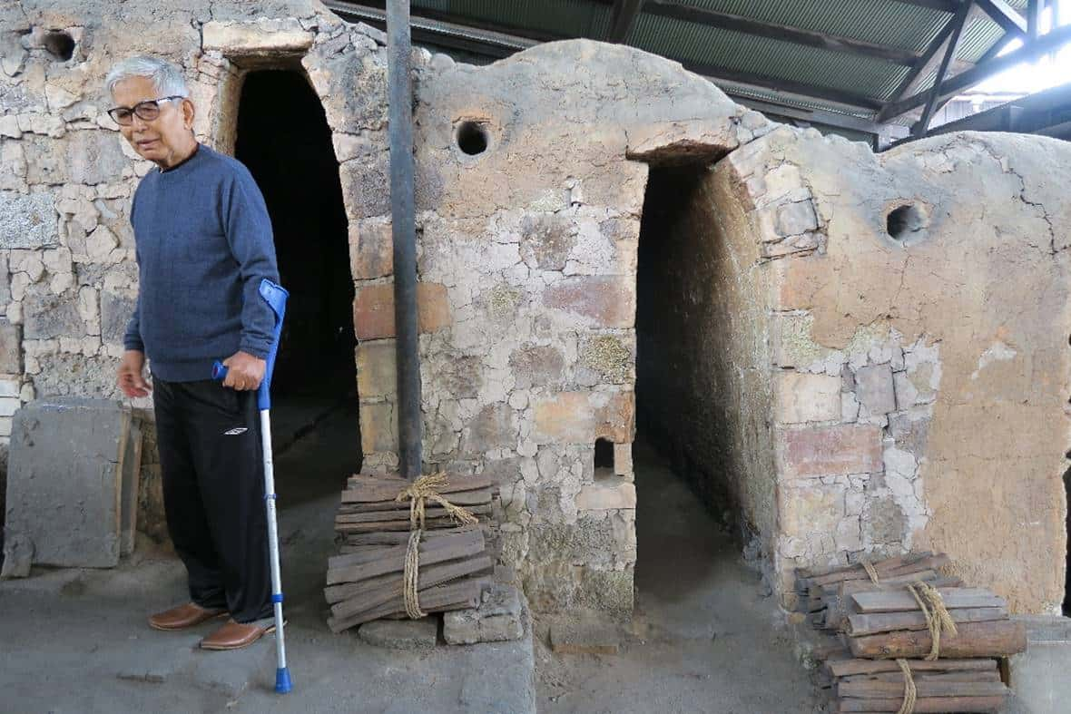Iskandar standing in front of the multi-chambered noborigama (step-up kiln) located within the compound of the Kawai Kenjiro House. The kiln was last fired up in 1971.