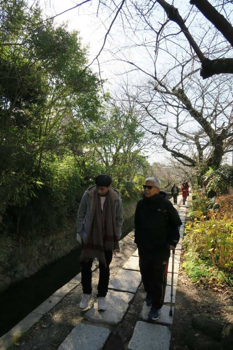 Strolling along the path called Philosopher's Walk in Kyoto. This roughly 2-kilometre path was named after one Japan's most significant and influential philosophers of the twentieth century, Nishida Kitaro, who used to walk along this path as one of his daily routines.