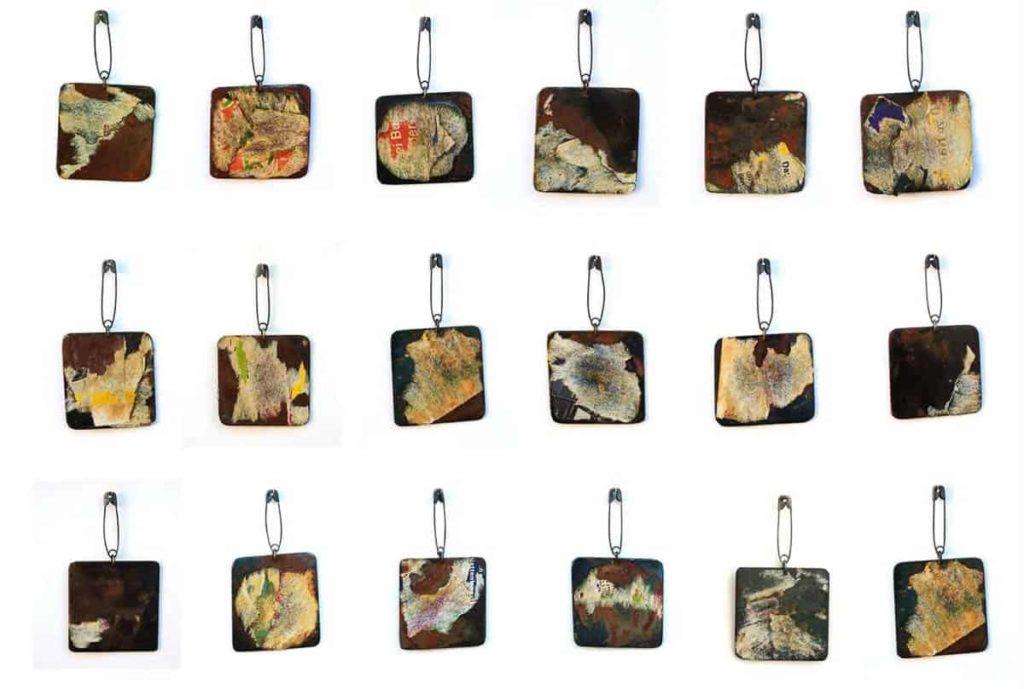 "Aiza Mahmood, ""Set us free"" pins, 2015, iron and paper , 2.5 x 1.5 inch (approx)"