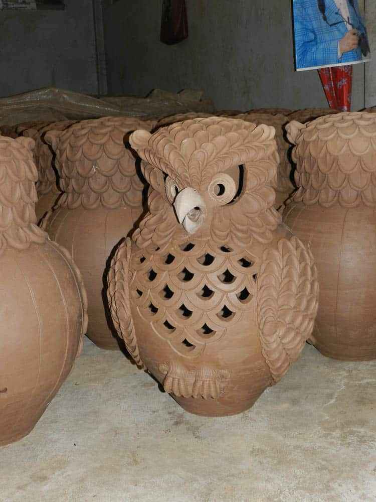 Drying owls awaiting firing.