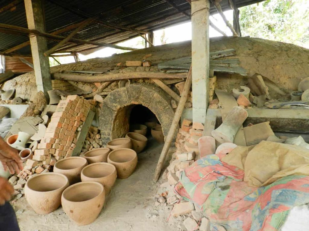 Pottery awaiting loading in the wood kiln.