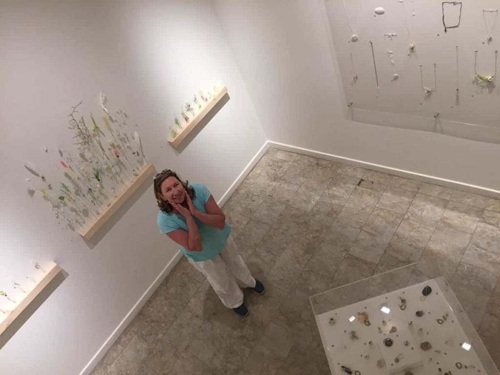Artist Kate Hunter views the final installation her show of All that Remains , photo is courtesy of Ashleigh Campbell