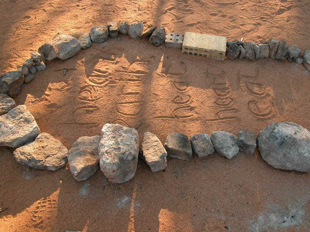 Nalda Searles, Hearth installation at bush camp in 2007, earth and stones with words