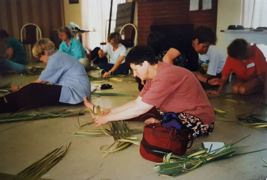 Gwen Egg participating in a weaving workshop taught by Maori weaver Tina Wirihana at the Moonah Arts Centre