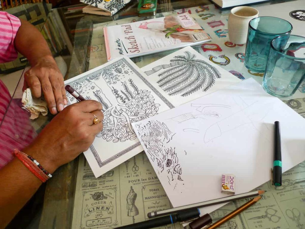 Pushpa creating individual drawings	early in the collaboration