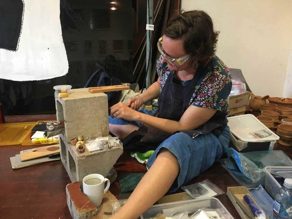 Contemporary Jewellery workshop teacher Melinda Young with her breezeblock artists bench